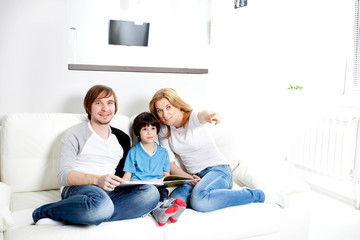 Portrait of friendly family reading book