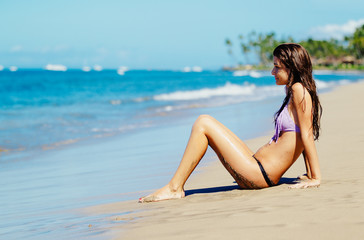 Young Woman Enjoying Sunny Day on the Beach