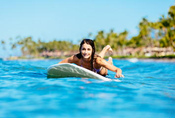 Young Woman Surfing in Hawaii, Paddling out to the Lineup