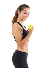 Profile of a young fitness woman doing weights exercises