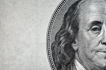 Dollars closeup..Detail of a Benjamin Franklin's portrait