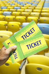 Soccer Fan Holding Two Brazil Tickets at Stadium