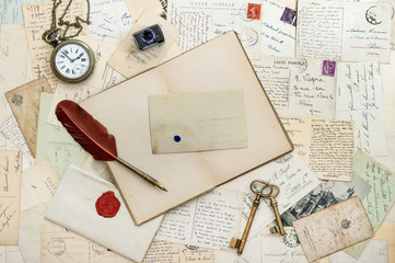 notebook, writing accessories and postcards