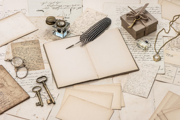 open notebook, old letters and accessories