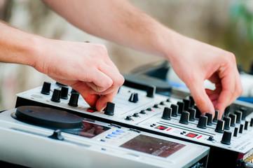 Close-up of sound mixer control panel with dj hands