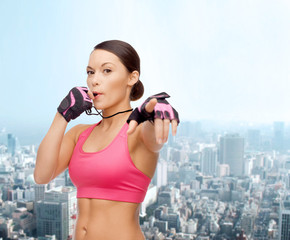 asian personal trainer with whistle