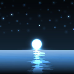 Blue moon over cold night water.