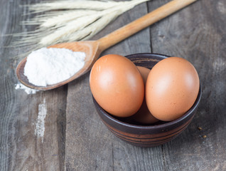 The flour and eggs on kitchen table