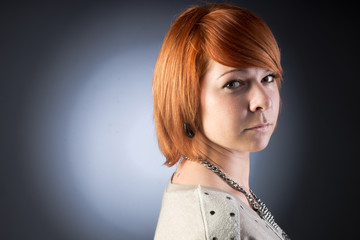 Young redhaired woman. Studio shot.