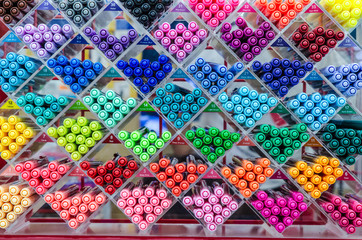 rack of brightly-colored pens