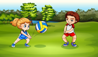 A girl and a boy playing volleyball