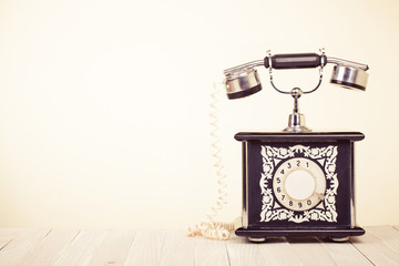 Vintage style telephone on wooden table