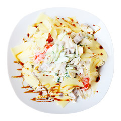 salad with tongue on white dish. Top view