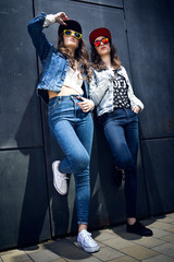 Young  girls with denim suit in a urban background