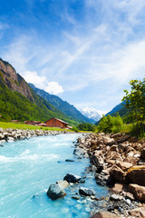 Wall Mural - Beautiful Swiss landscape with river stream