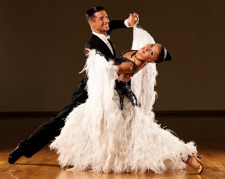 Professional ballroom dance couple preform an exhibition dance
