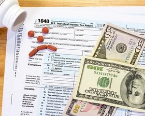 aspirins make a sad face on a tax form