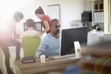 Man working on desktop computer