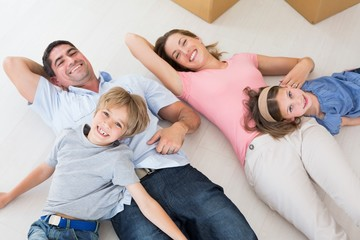 Family lying in their new house