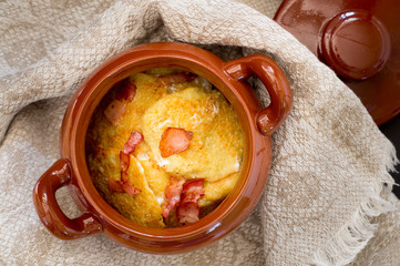 Traditional belarussian potato pancakes in a clay pot
