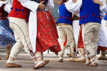 Horizontal colour image of female polish dancers in traditional