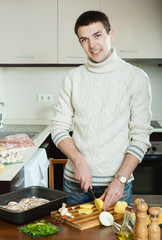 man cutting potato