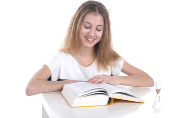Schoolgirl reading on a white background