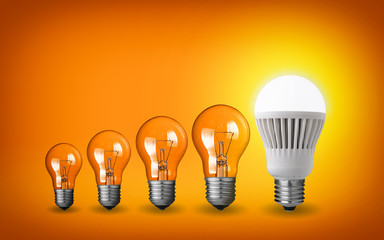 Row of light bulbs.Idea concept on orange background.