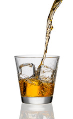 Fototapete - whiskey being poured into a glass