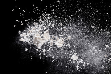 Flour in freeze motion over black