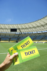Soccer Fan Holding Two Brazil Tickets at the Stadium