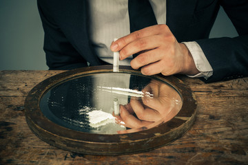Businessman snorting cocaine