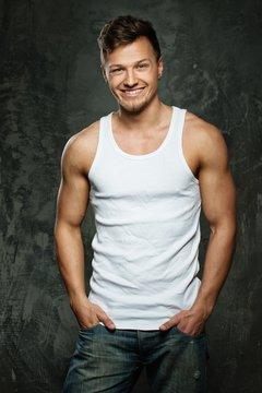 Stylish cheerful man in tank top shirt
