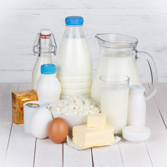 Dairy products on white wooden table still life