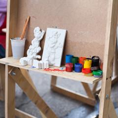 easel paint brush figures