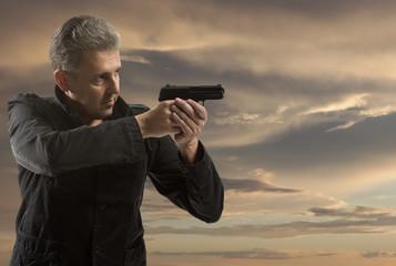 Portrait Of Man Holding Gun