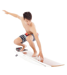 young  surfer practice surfing pose