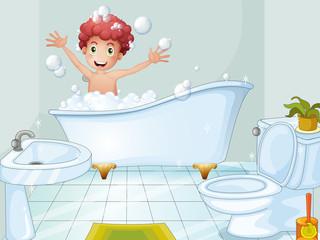 A cute boy taking a bath