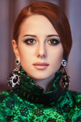 Portrait of a beautiful redhead women with earrings.