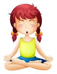 A little girl doing yoga