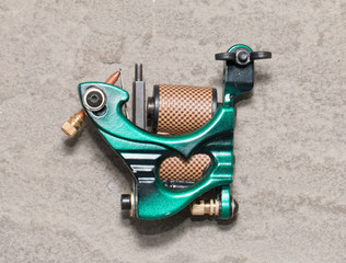 Tattoo machine ( gun ).