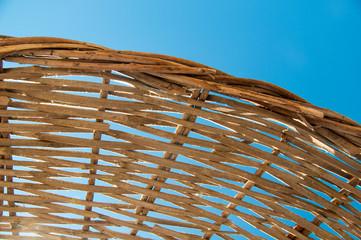 Background  rattan parasol of wicker