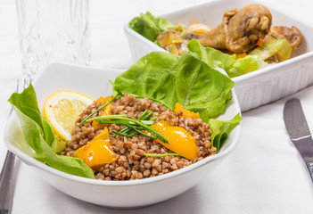 buckwheat with lemon and letuce and fried chicken