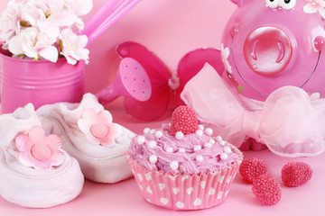 Cupcake and baby decoration in pink color