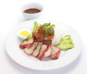 red pork with white rice and sauce