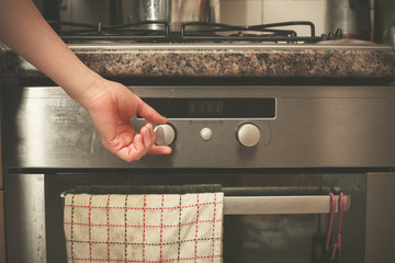 Hand turning knob on stove