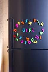 Word Girl spelled out using colorful magnetic letters