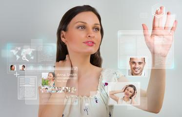 Wall Mural - Young pretty woman using social media virtual interface