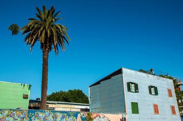 Leinwandbilder - Blue Building in Historic Neighborhood