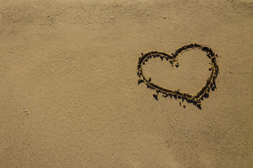 Heart drawn on sand on the beach